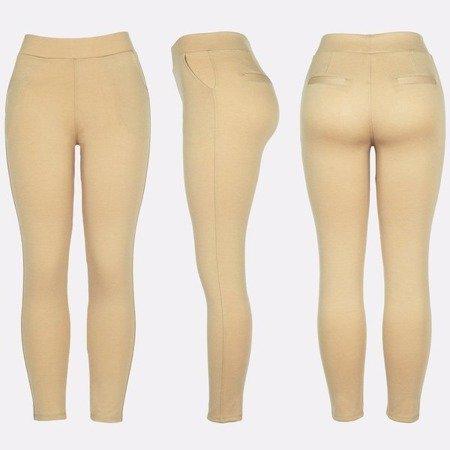 Beżowe legginsy z kieszeniami - Spodnie