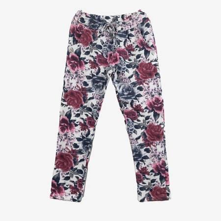 Białe bawełniane spodnie dresowe w wielokolorowe kwiaty - Spodnie