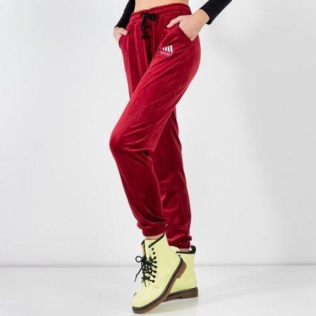 Bordowe damskie spodnie dresowe - Odzież