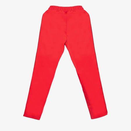 Czerwone spodnie dresowe z lampasami - Odzież