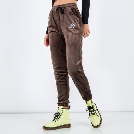 Damskie spodnie dresowe w brązowym kolorze - Odzież