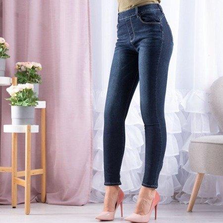 Granatowe jeansy z kokardami - Spodnie