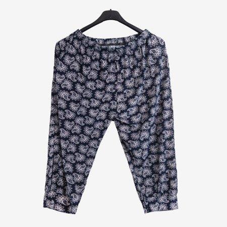 Granatowe wzorzyste damskie spodnie typu rybaczki - Odzież