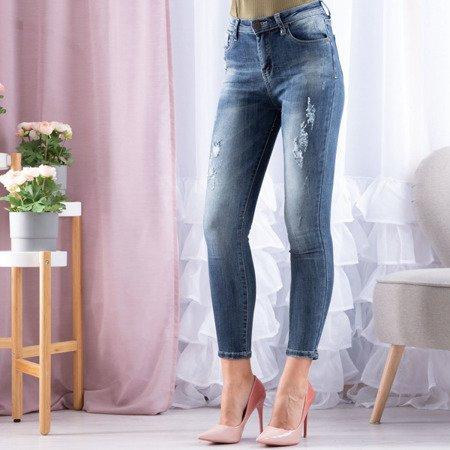 Jeansowe spodnie z przetarciami - Spodnie