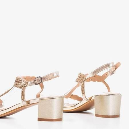 OUTLET Złote sandały na niskim słupku z cyrkoniami Doremies - Obuwie