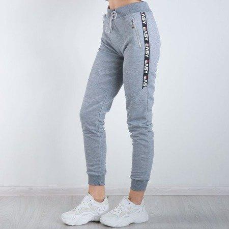 Szare spodnie dresowe z napisami Spodnie