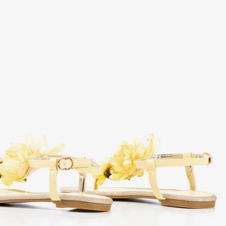 Żółte sandały z ozdobnym kwiatkiem Nosta - Obuwie